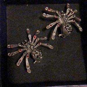 2 silver tone spider brooches with little gems